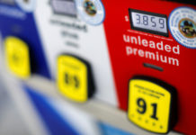 The current price of gasoline is shown on a gas pump at an Arco gas station in San Diego