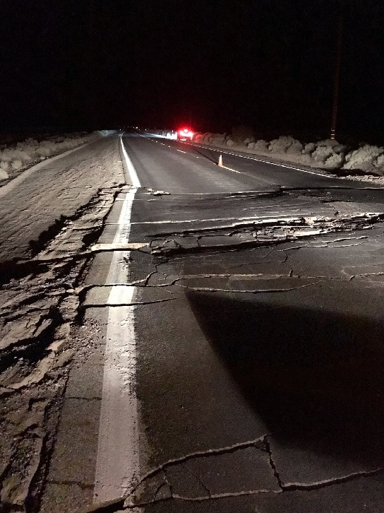 Cracks emerge on a road after an earthquake broke in Trona, California, U.S., in this photo from the USGS posted on July 6, 2019. USGS/Handout via REUTERS